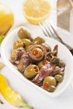 Olive and anchovy salad Stock Images