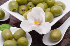 Olive appetizer. S on a brown plate stock photo