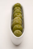 Olive appetizer. On a white backgorund stock photo