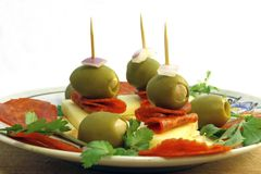 Olive appetizers. A plate of olive appetizers with garlic, pepperoni, cheese and onions Stock Images