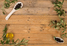 Olive background on a rustic table Royalty Free Stock Photo