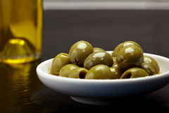 Olive bowl with olive oil Royalty Free Stock Photo