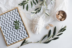 Olive branches and ceramic decor. Decorative objects flatlay on white background. Olive branches and ceramic decor Stock Image