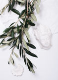 Olive branches and ceramic decor Royalty Free Stock Images