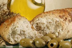 Olive bread. And olives set on a gingham tablecloth Royalty Free Stock Photography