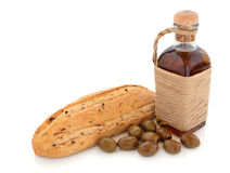 Olive Bread, Oil and Olives. Olive bread and olives with bottle of olive oil wrapped in raffia over white background Royalty Free Stock Photography