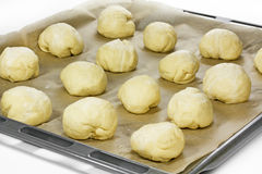 Olive bread rolls on a baking tray. On baking paper Stock Photo