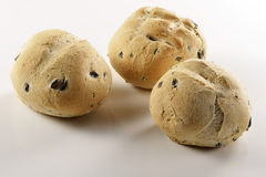 Olive bread. Small round bread and olives on white background Stock Photography