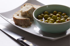 Olive and Bread Starter Royalty Free Stock Image