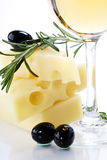 Olive, cheese and white wine Stock Photos