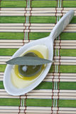 Olive in a china spoon Stock Image
