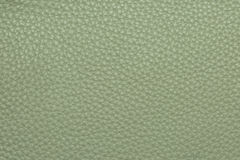 Olive colored leather grained texture background pattern Royalty Free Stock Photos