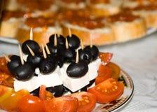 Olive con i pomodori ed il formaggio Fotografie Stock