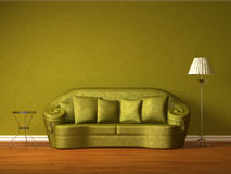 Olive couch with table and standard lamp Stock Images
