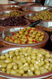Olive display on market stall. Different types of olives on a market stall Royalty Free Stock Photography