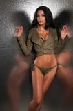 Olive drab. Beautiful young multiracial woman in olive drab royalty free stock images
