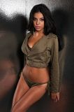 Olive drab. Beautiful young multiracial woman in olive drab Royalty Free Stock Photography