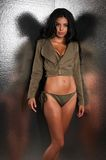 Olive drab. Beautiful young multiracial woman in olive drab Stock Photo