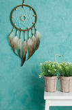 Olive dream catcher on aquamarine Royalty Free Stock Images