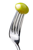 Olive On A Fork. Garlic Stuffed Olive Speared On A Fork, Isolated On A White Background Stock Images