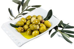 Olive fruit and leaves soaked in olive oil Stock Photo