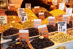 Olive fruits on market display Stock Photos