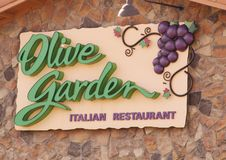 Sign of the Olive Garden Italian Restaurant. Olive Garden is a family restaurant, providing their guests with genuine Italian dining.  Inspired by the Italian Stock Image