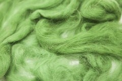 Olive green piece of Australian sheep wool Merino breed close-up on a white background Royalty Free Stock Images