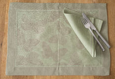 Olive Green Rectangular Placemat with Butterfly Design. An olive green placemat with embroidered butterfly design laid spread out with matching color napkin Stock Photos