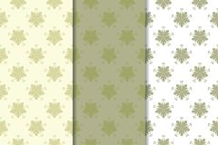 Olive green set of floral ornaments. Seamless patterns. For textile and wallpapers Stock Image