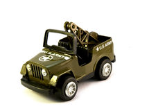 Olive green toy US Army jeep. A green metal toy Tractor Stock Photography