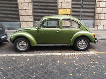 Olive green Volkswagen Beetle car Royalty Free Stock Photography