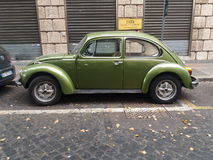 Olive green Volkswagen Beetle car Royalty Free Stock Photos