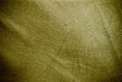 Olive holed and creased canvas background or texture Stock Image