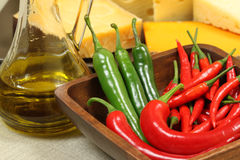 Olive jar and peppers Royalty Free Stock Images