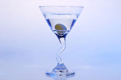 Olive Martini. With olive splashing into it Royalty Free Stock Images