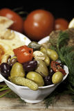 Olive Medley. Olives, pickles and peppers in a white bowl Royalty Free Stock Photos