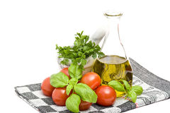 Olive oi, tomatoes, basil and parsley Stock Image