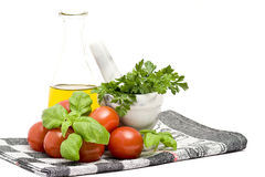 olive oi, tomatoes, basil and parsley Stock Images