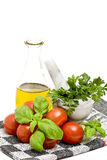 Olive oi, tomatoes, basil and parsley Stock Photography