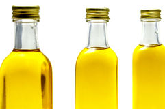 Olive oil. Some bottles of olive oil isolated on a white background royalty free stock photo