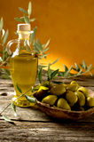 Olive oil. Bottle of Olive oil with  olive over bowl Royalty Free Stock Photography