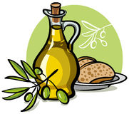 Olive oil. Bottle of olive oil, branch and sliced bread Stock Images