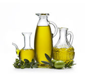 Olive Oil 2. Three bottles of olive oil with two olives and spices on white background Royalty Free Stock Image