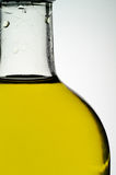 Olive oil. Bottle back lit macro closeup Royalty Free Stock Images