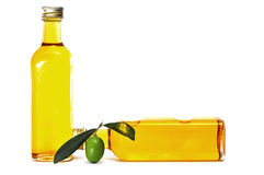 Olive oil. Some bottles of olive oil on a white background royalty free stock image