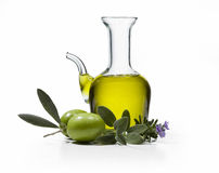 Olive Oil 3. A bottle of olive oil with two olives and spices on white background Stock Photography