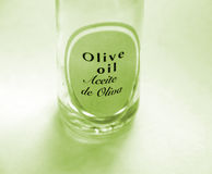 Olive oil. In a bottle with label- Aceite de Olivia Royalty Free Stock Photography