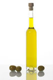 Olive oil. Bottle of olive oil and three olives isolated on white Royalty Free Stock Photo