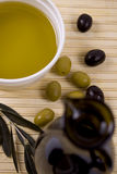 Olive oil. With green and black olives Royalty Free Stock Photo